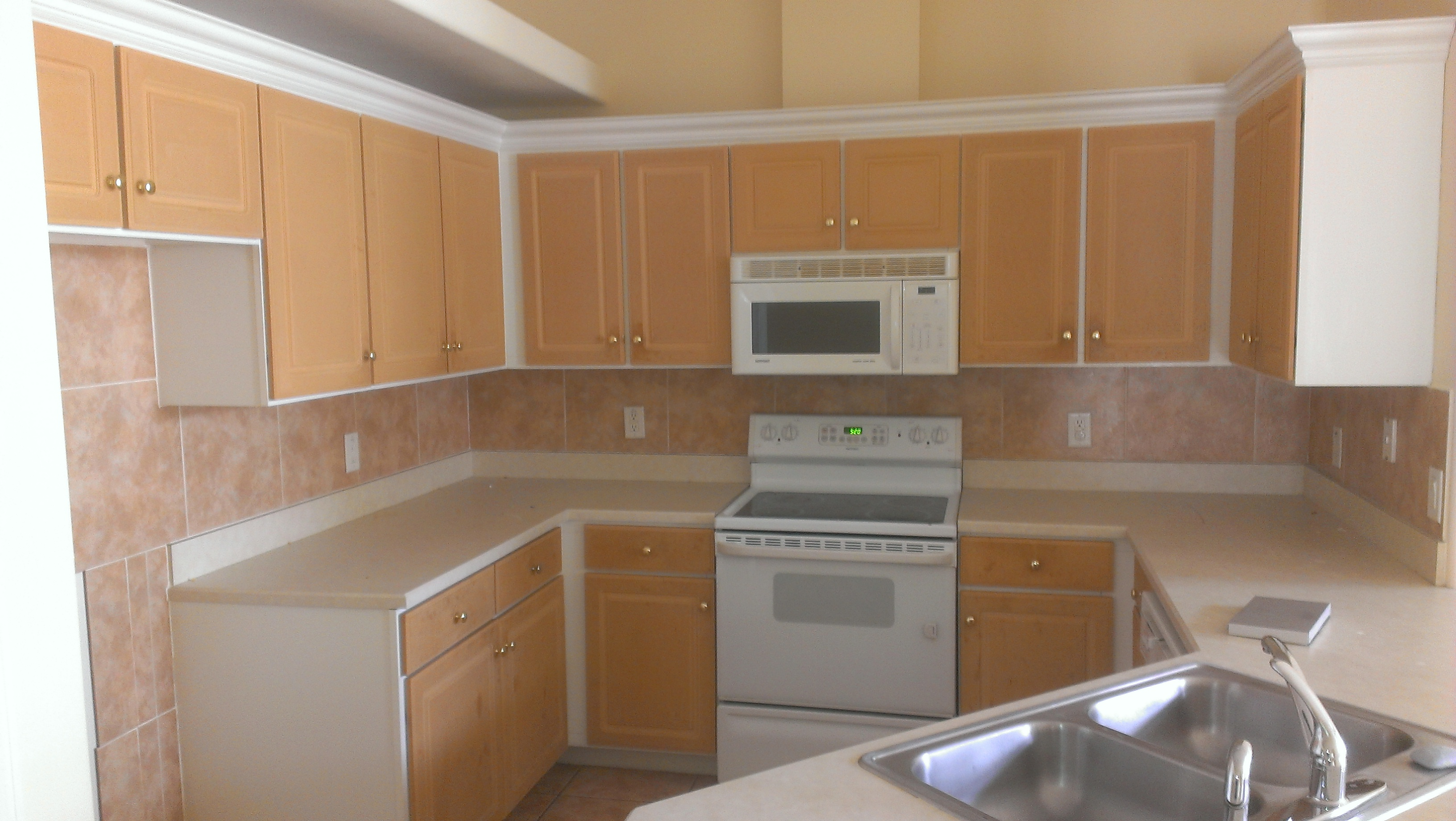 Cabinet refinishing expert in daytona beach florida for Making old kitchen cabinets look modern